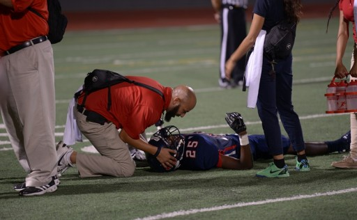Renee Fernandes/NATA Aaron Ellis, MEd, ATC, LAT, the athletic trainer at Kimball High School in Dallas, TX helps kids on the field and on the sidelines during the football team's opening game.